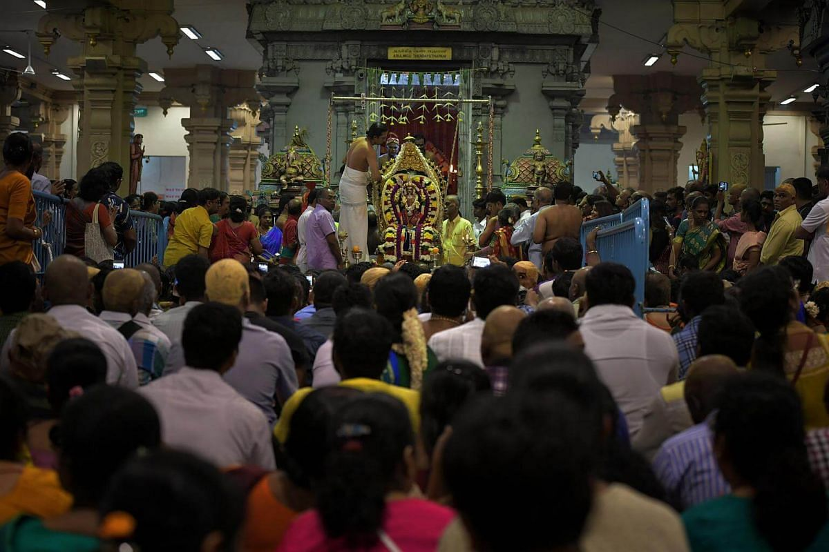 Devotees sit together awaiting the installation of Sri Murugan in the temple as the chariot carrying Sri Murugan arrives at the Sri Thendayuthapani Temple on Feb 8, 2017. To Hindus, Lord Murugan is the destroyer of evil.
