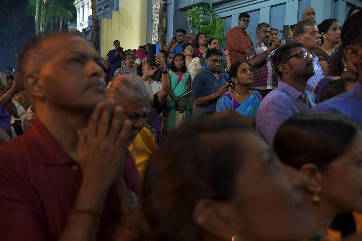 Devotees pray to Sri Murugan as the chariot arrives at the Sri Thendayuthapani Temple on the evening of Feb 8, 2017.