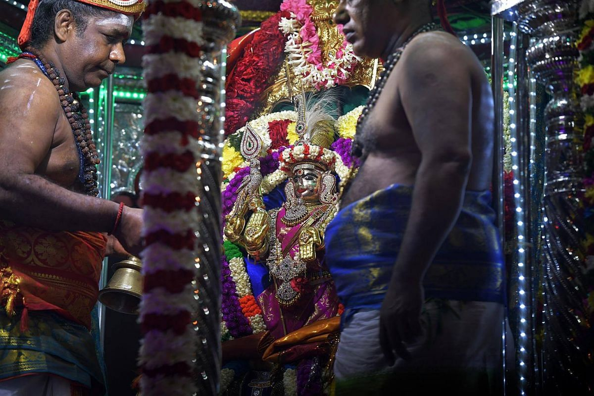 The chariot carrying Sri Murugan arrives at the Sri Thendayuthapani Temple on the evening of Feb 8, 2017. Devotees seek blessings and fulfil their vows by carrying milk pots as offerings. Many also carry kavadis and pierce their bodies with steel rod