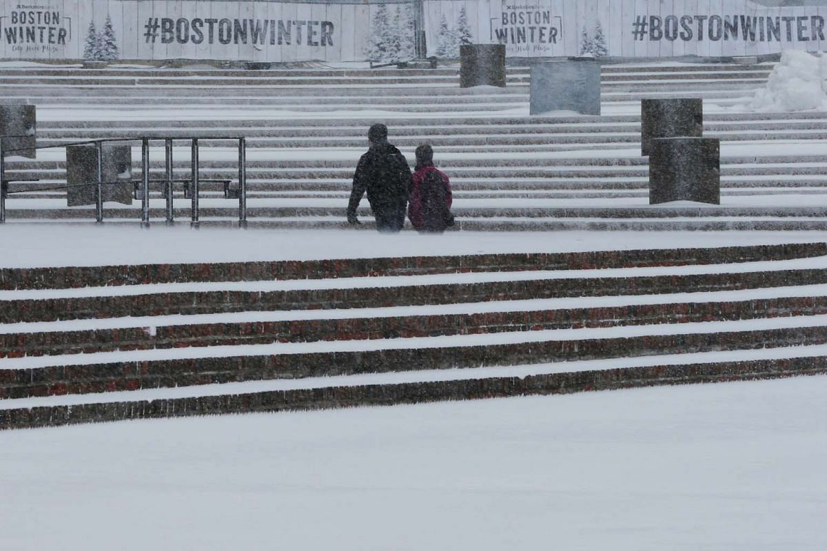 Pedestrians making their way across City Hall Plaza during a winter storm in Boston, Massachusetts, US, on Feb 9, 2017.