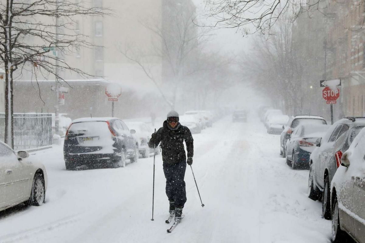 A man using cross-country skis to travel down a street during a heavy snow storm in the Brooklyn borough of New York City, US, on Feb 9, 2017.