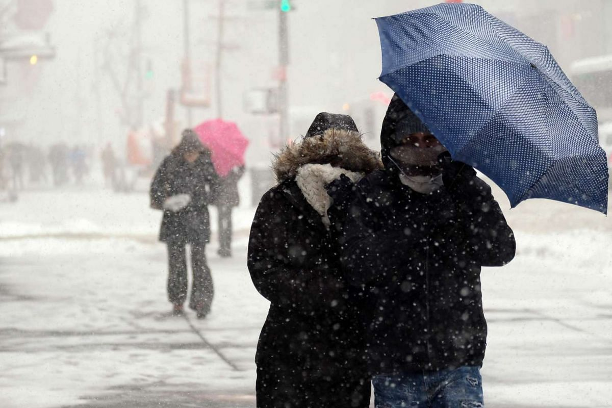People making their way during a winter storm in New York, US, on Feb 9, 2017.