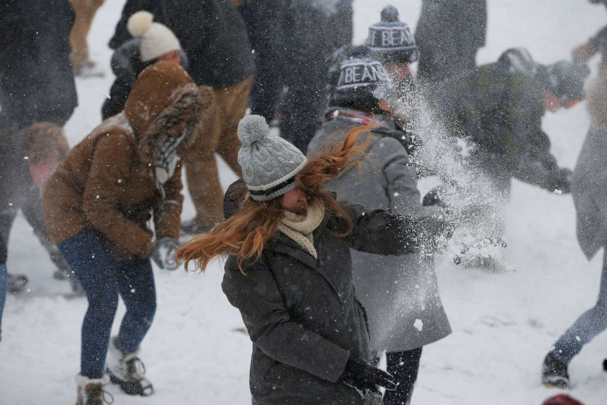 Several hundred people taking part in a snowball fight on Boston Common during a winter storm in Boston, Massachusetts, US, on Feb 9, 2017.