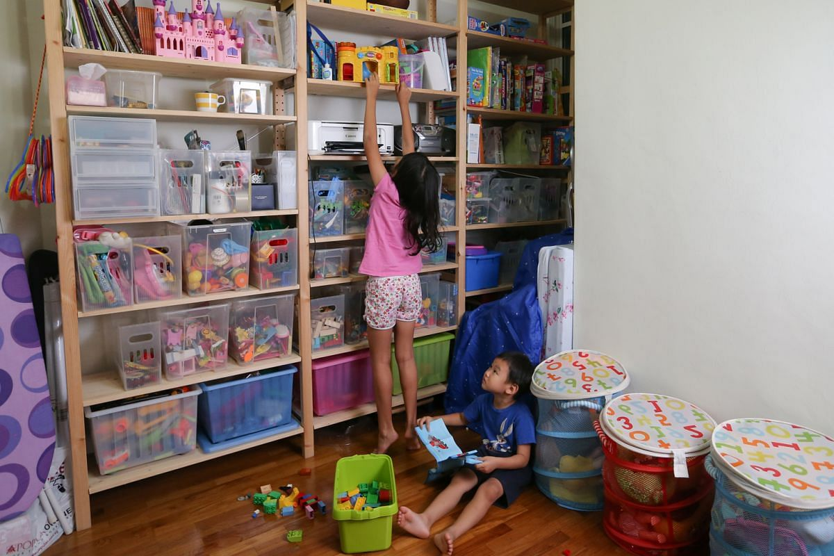 AFTER: A new shelving system for the toys belonging to her four children, including her two younger ones – Catherine, eight, and Dominic, four (both above).