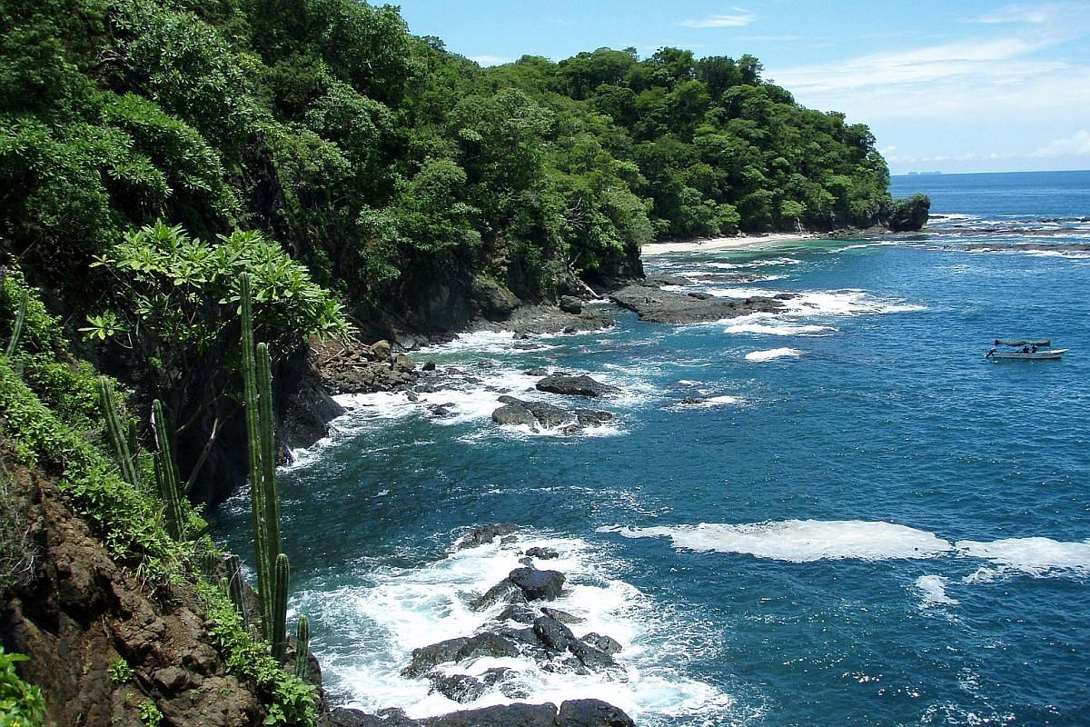 The 2km-long grey sand beach at Playa Hermosa is surrounded by tropical forest and ridges of volcanic rock.