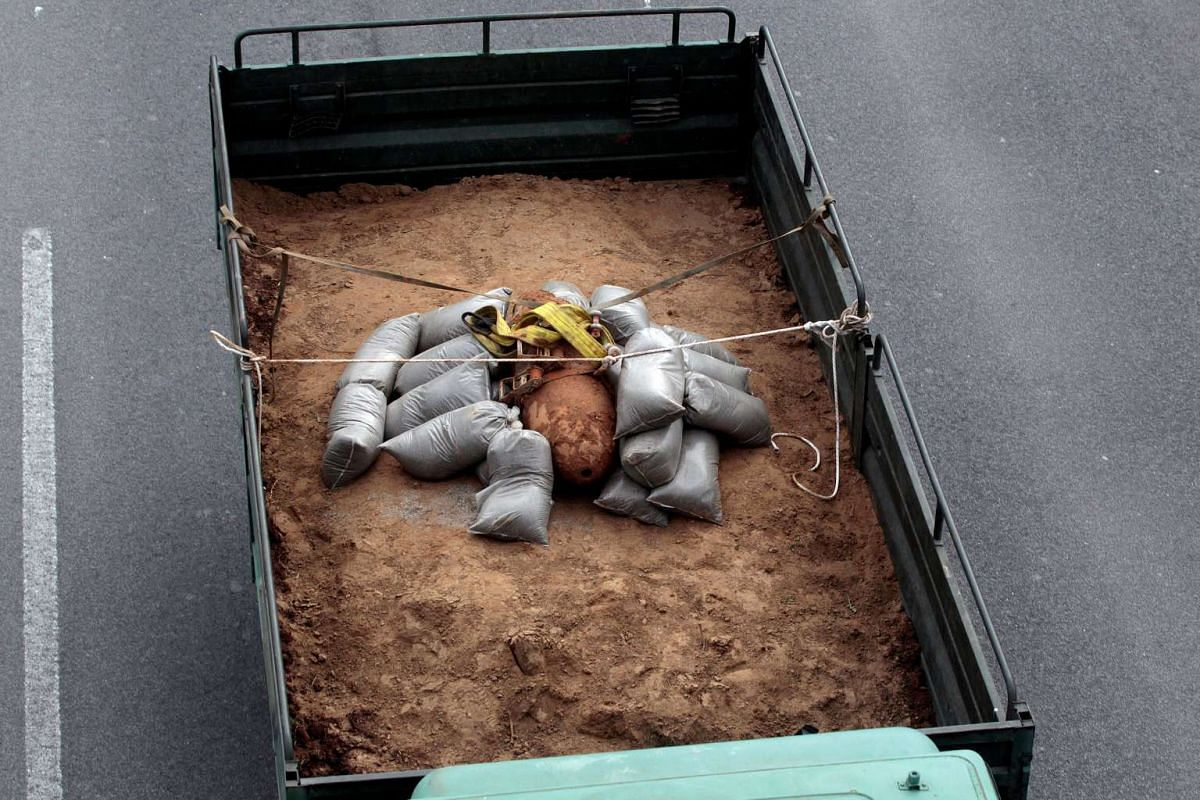 A 250 kg World War Two bomb that was found during excavation works at a gas station, is carried on a military truck, following an operation to defuse it, in the northern city of Thessaloniki, Greece, February 12, 2017. PHOTO: REUTERS
