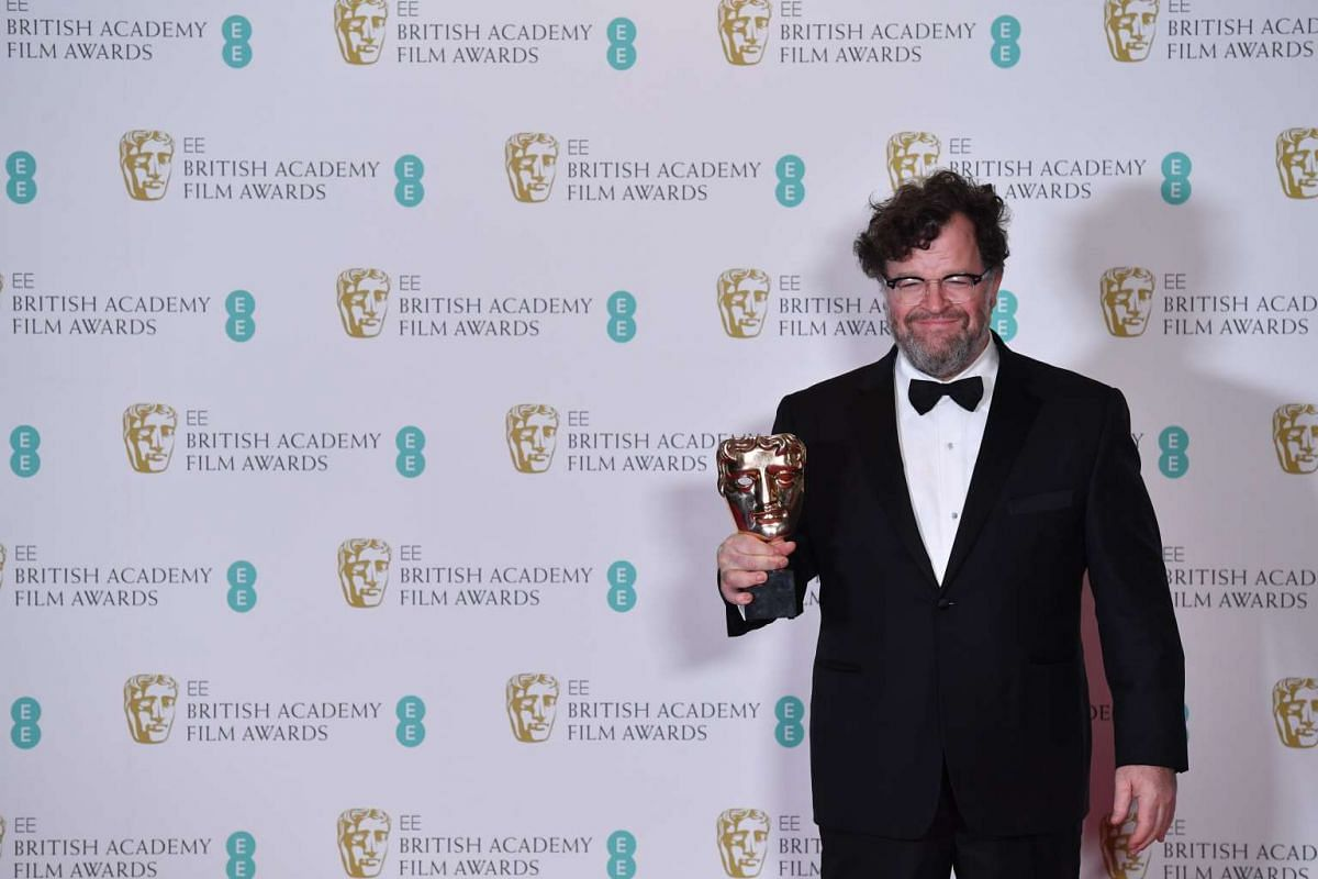 Director Kenneth Lonergan poses with the award for an Original Screenplay for the film Manchester By The Sea.