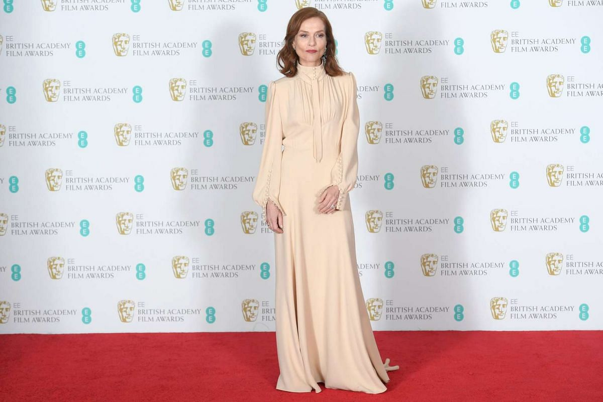 French actress Isabelle Huppert arrives for the Baftas.