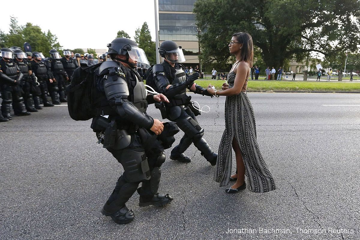 First Prize Contemporary Issues (Singles). Demonstrator Ieshia Evans protesting the shooting death of Alton Sterling is detained by law enforcement near the headquarters of the Baton Rouge Police Department in Baton Rouge, Louisiana, on July 9, 2016.