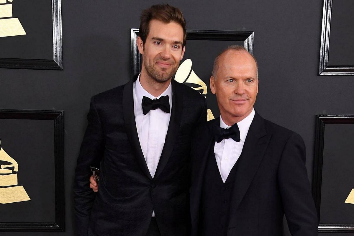 Michael Keaton (right) and Sean Douglas arriving for the 59th Grammy Awards pre-telecast on Feb 12, 2017, in Los Angeles, California.