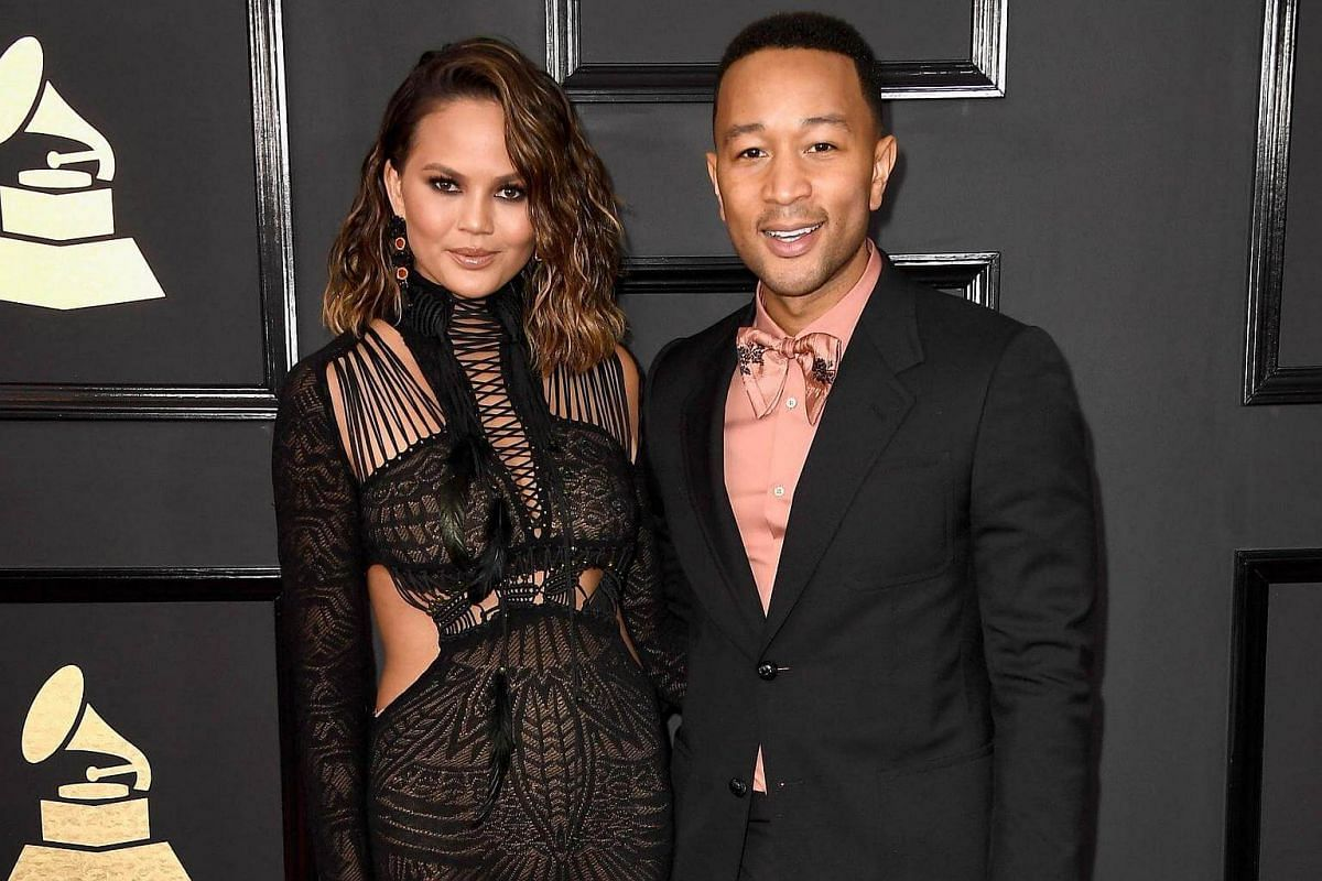 Model Chrissy Teigen and musician John Legend arriving at the 59th Grammy Awards at Staples Center on Feb 12, 2017 in Los Angeles, California.