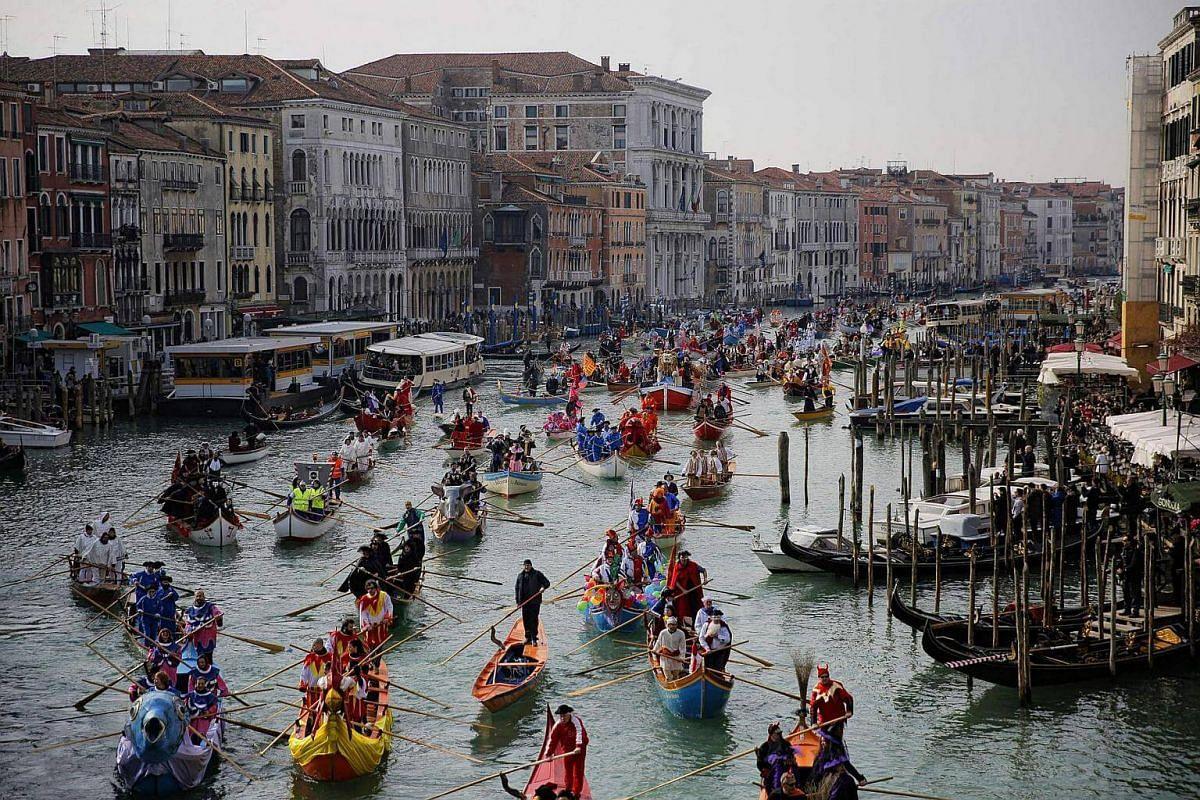 People rowing during the masquerade parade on Grand Canal during the Venice Carnival on Feb 12, 2017, in Venice, Italy.