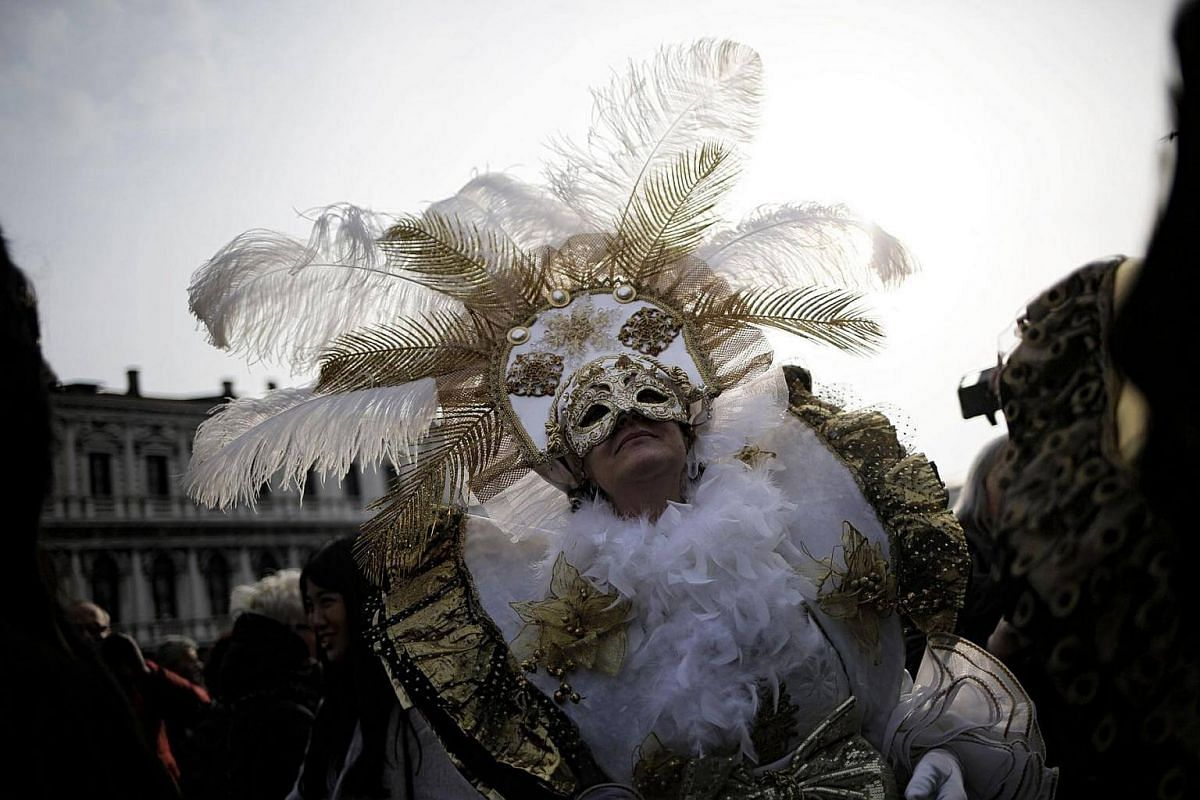A reveller in a period costume taking part in the Venice Carnival on Feb 12, 2017, in Venice, Italy.