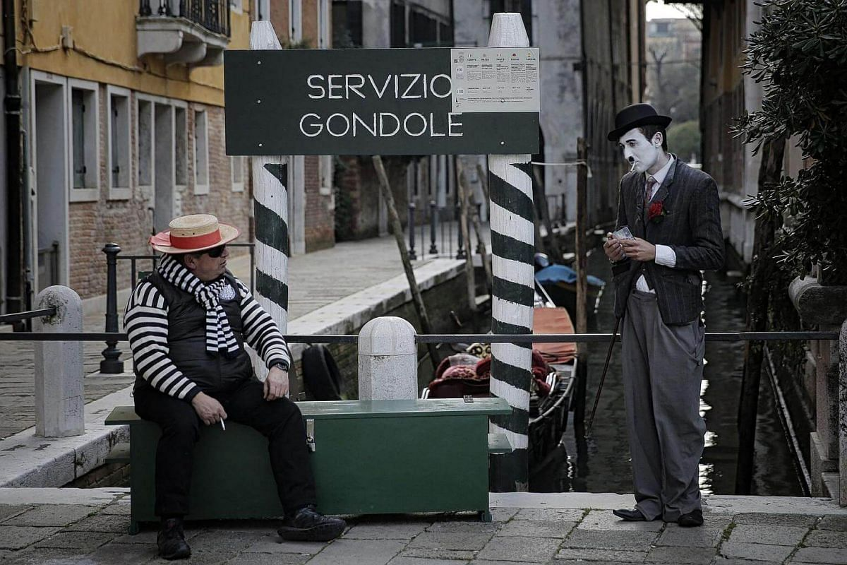 Revellers in period costumes at the Venice Carnival on Feb 12, 2017, in Venice, Italy.