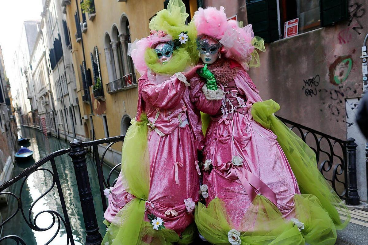 Masked revellers posing during the Venice Carnival in Venice, Italy, on Feb 12, 2017.