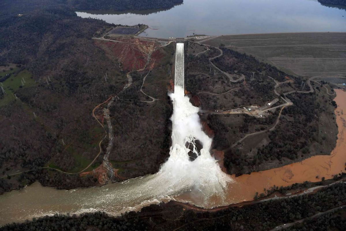 The Oroville Dam releasing water down the main spillway in Oroville, California, on Feb 13, 2017. The spillway can release water at the rate of  100,000 cubic feet per second.