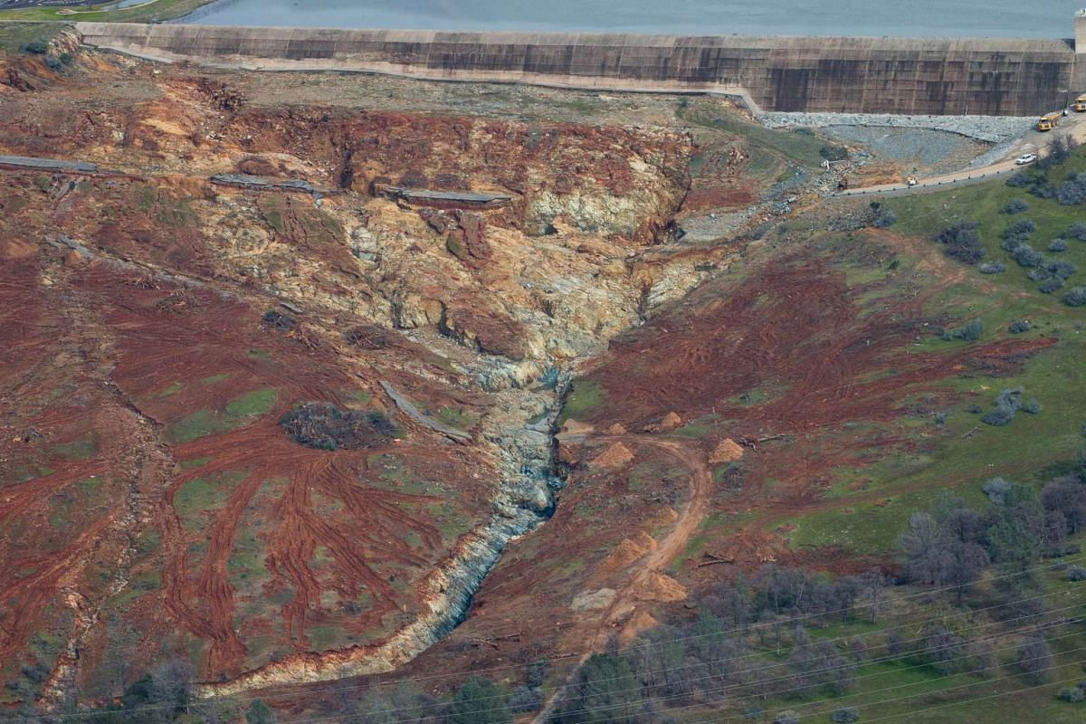 The Oroville Lake emergency spillway and the erosion damage below it is seen from the air on Feb 13, 2017.