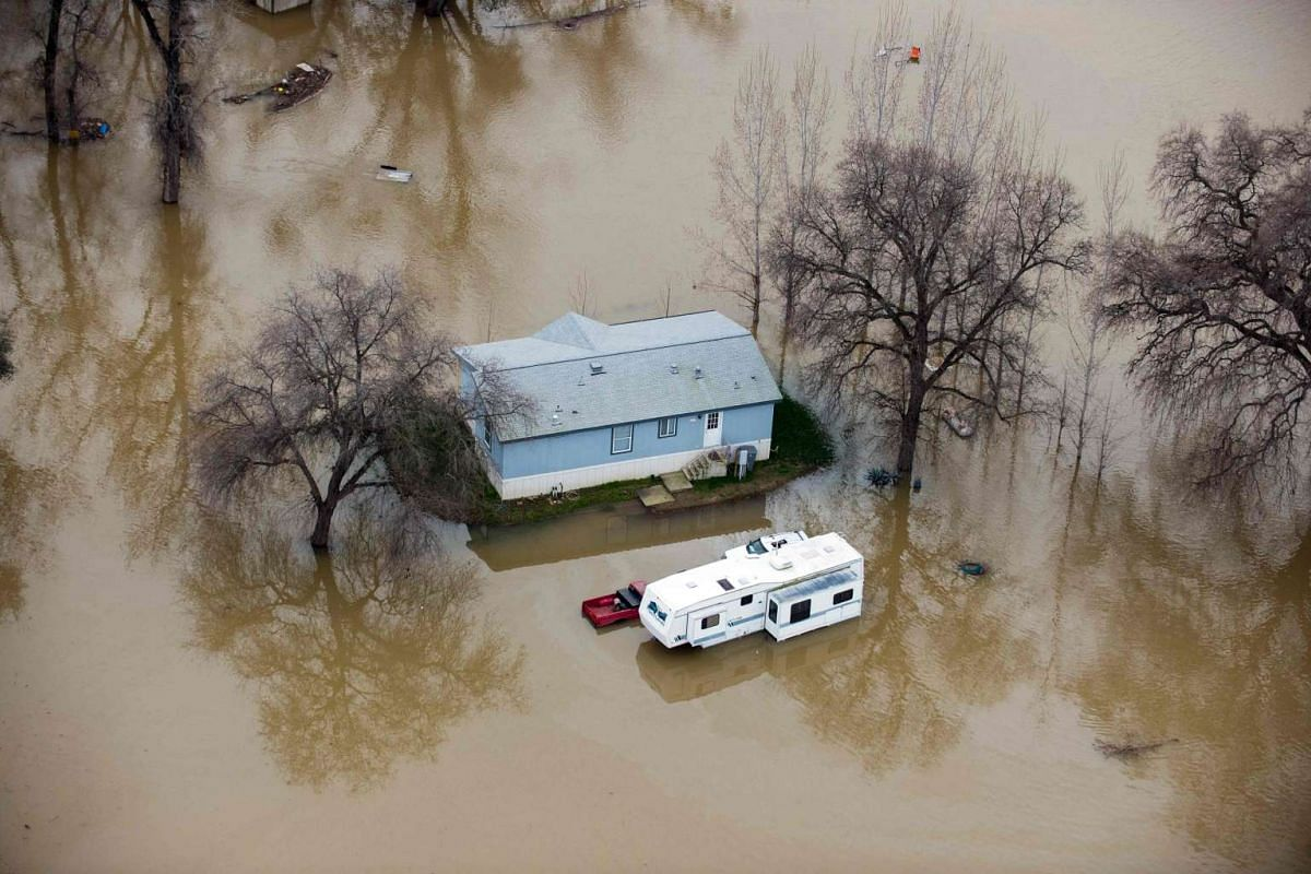 A house is seen surrounded by flood waters in Oroville, California, on Feb 13, 2017.