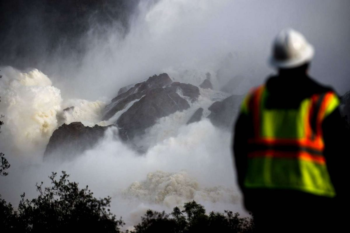 A water utility worker looking towards discharging water as it is released down a spillway as an emergency measure at the Oroville Dam in California on Feb 13, 2017.