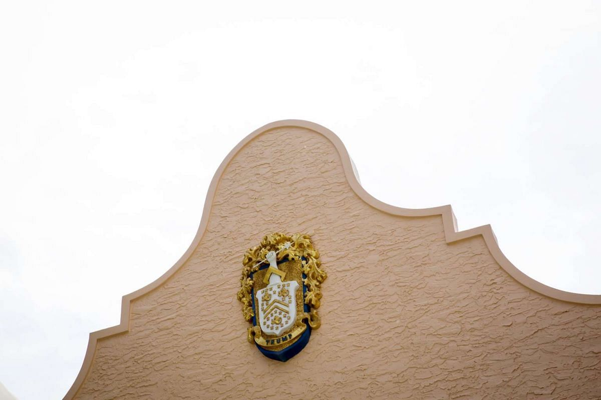 The Trump crest is seen on the facade of the Mar-a-Lago estate in Palm Beach, Florida.