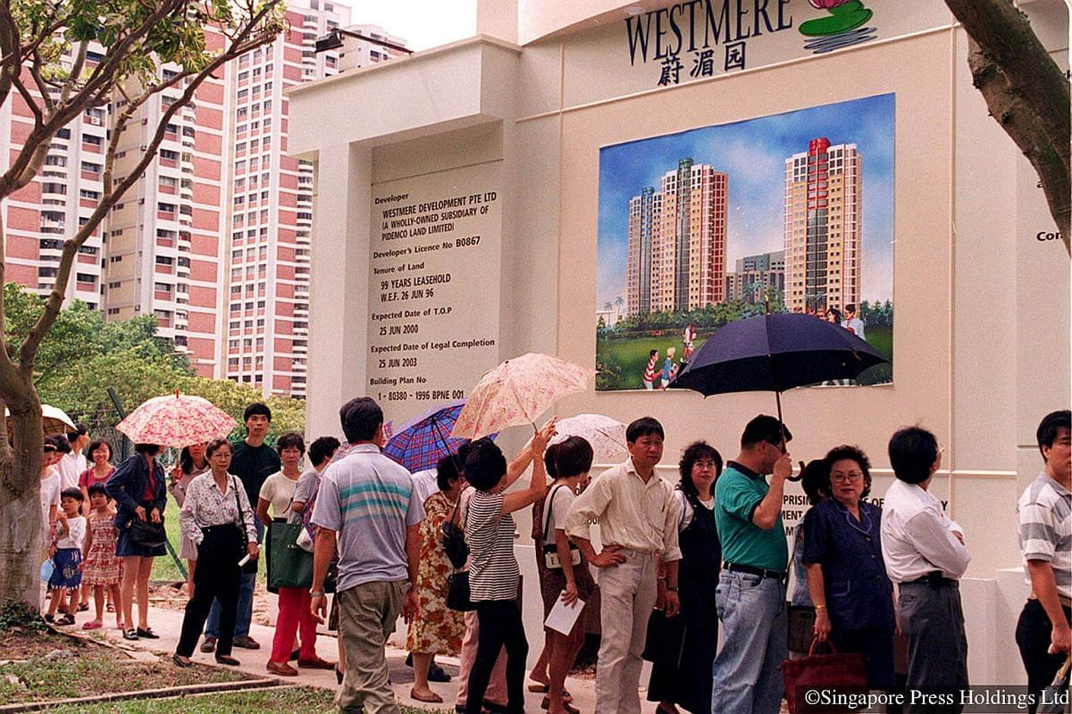1996: The crowd came prepared with their umbrellas to wait in the hot sun to view Westmere showflats in Jurong East. It was the first batch of executive condominiums to be built and sold. These condominiums come with facilities similar to private con