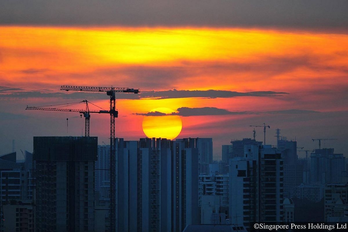 2010: The sun setting over public and private housing blocks.