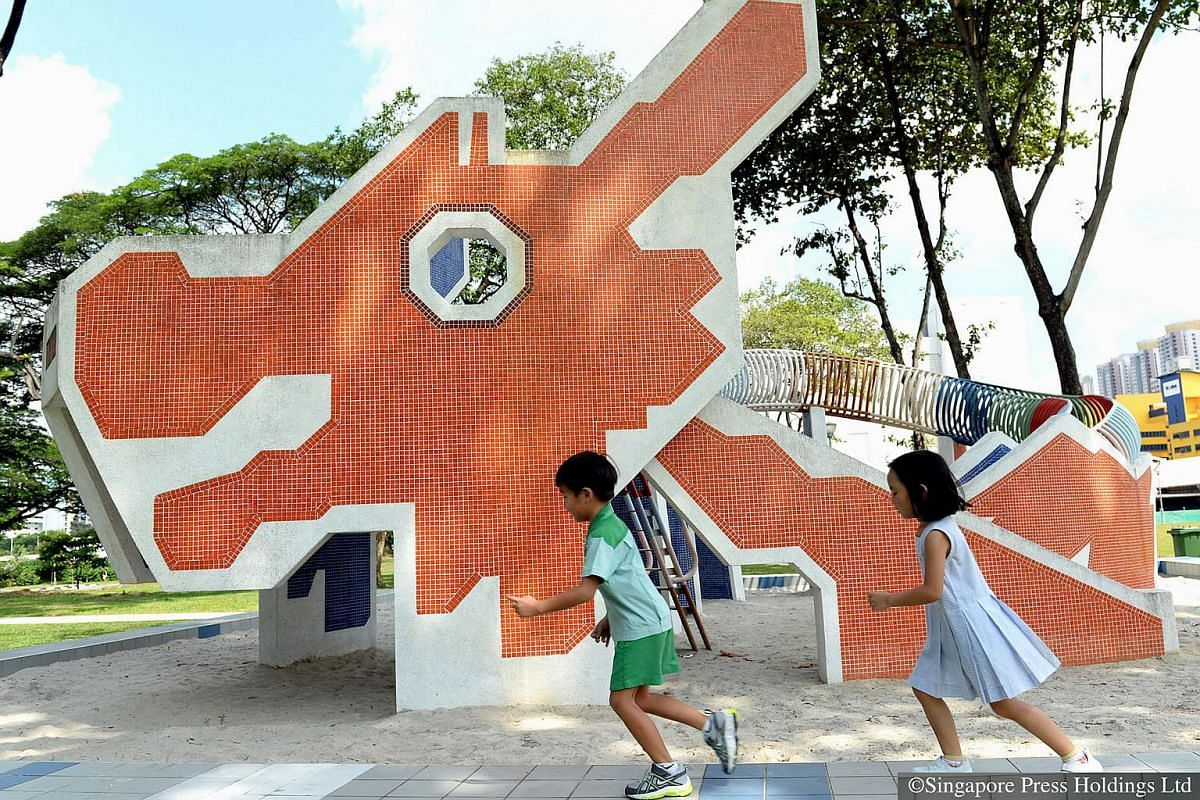 2015: Two kindergarten students playing at the iconic dragon playground in Toa Payoh. It was designed by Mr Khor Ean Ghee, who was an interior designer with HDB. The playground has been there since 1979, and retains its original sand surface.