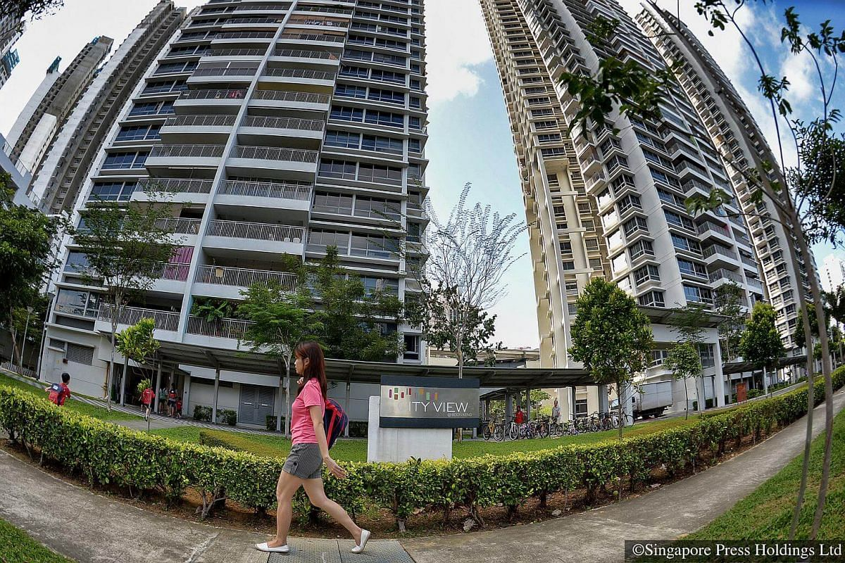2016: A woman walking past the Design, Build and Sell Scheme (DBSS) flats of City View@Boon Keng. DBSS was a scheme where public housing flats were developed and sold by private developers and not HDB. Meant to provide condominium-style homes, the sc