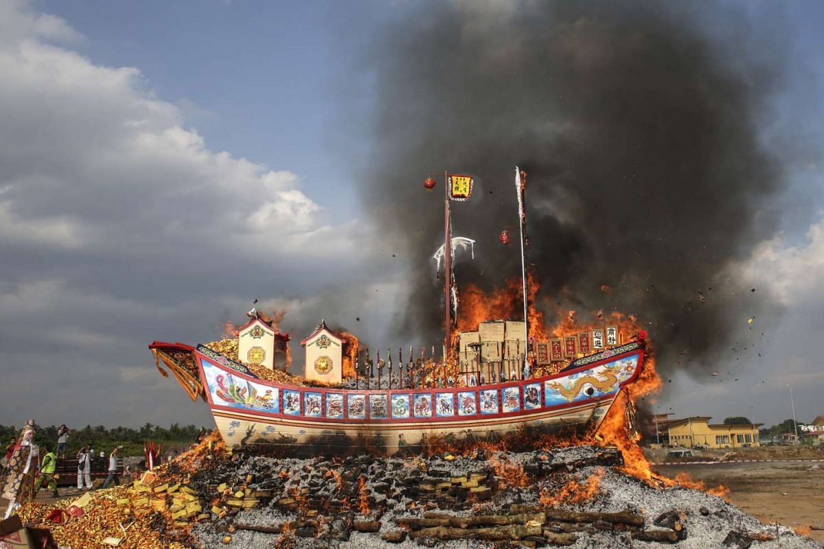 A picture made available on February 14, 2017 shows a ship-shaped float known as 'Wangkang' (Royal Barge) burning during Wangkang Festival celebrations in Malacca, Malaysia, February 10, 2017. The Wangkang festival is a festival which dates back to t