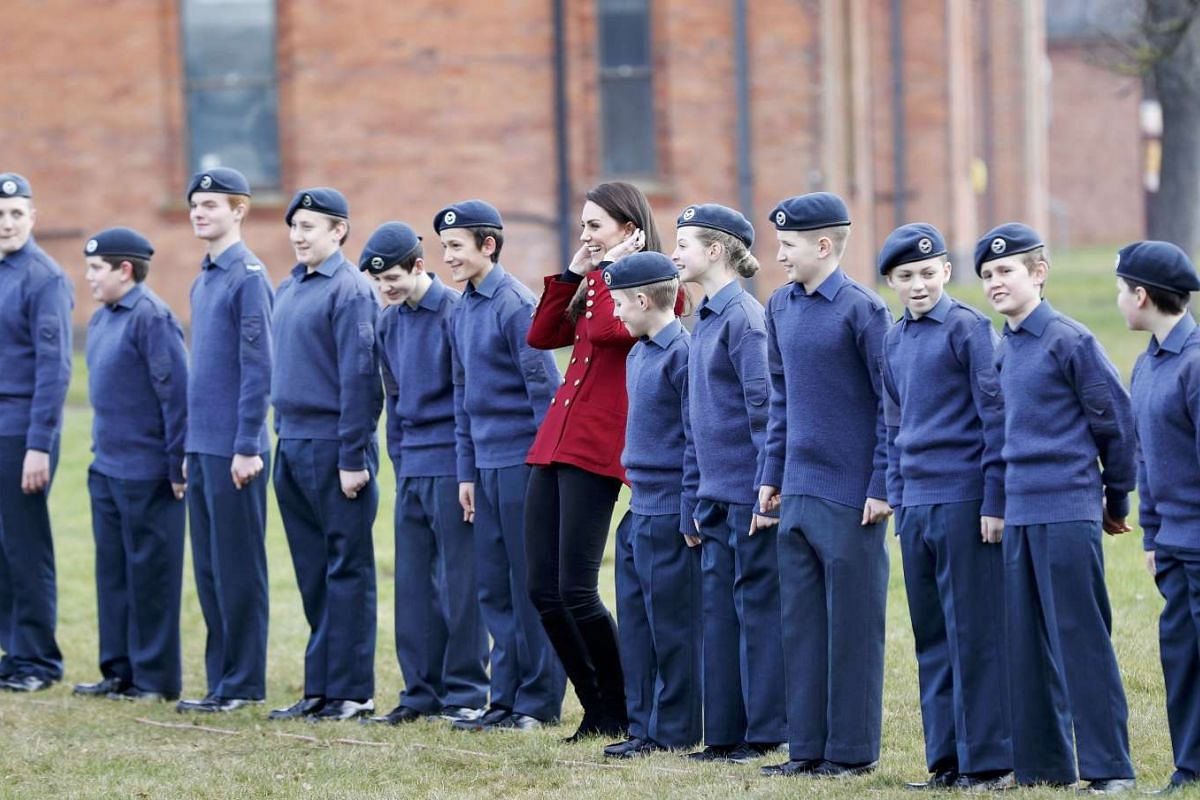 Britain's Catherine, the Duchess of Cambridge stands with cadets taking part in a team building during a visit to RAF Wittering, February 14, 2017. PHOTO: REUTERS