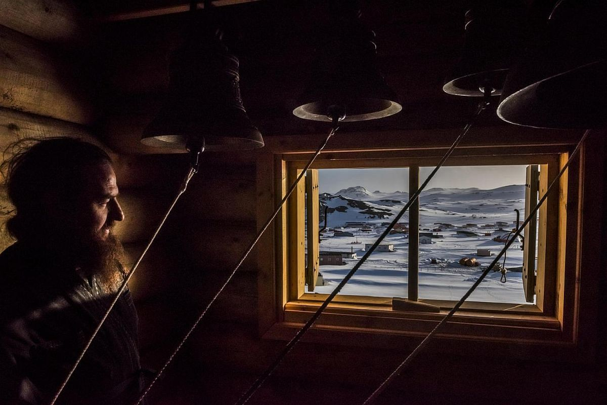 A priest looks on in the Bell room, after a vigil at the Russian Orthodox Church of the Holy Trinity; Fildes Bay, Antartica, on Dec 3, 2015.