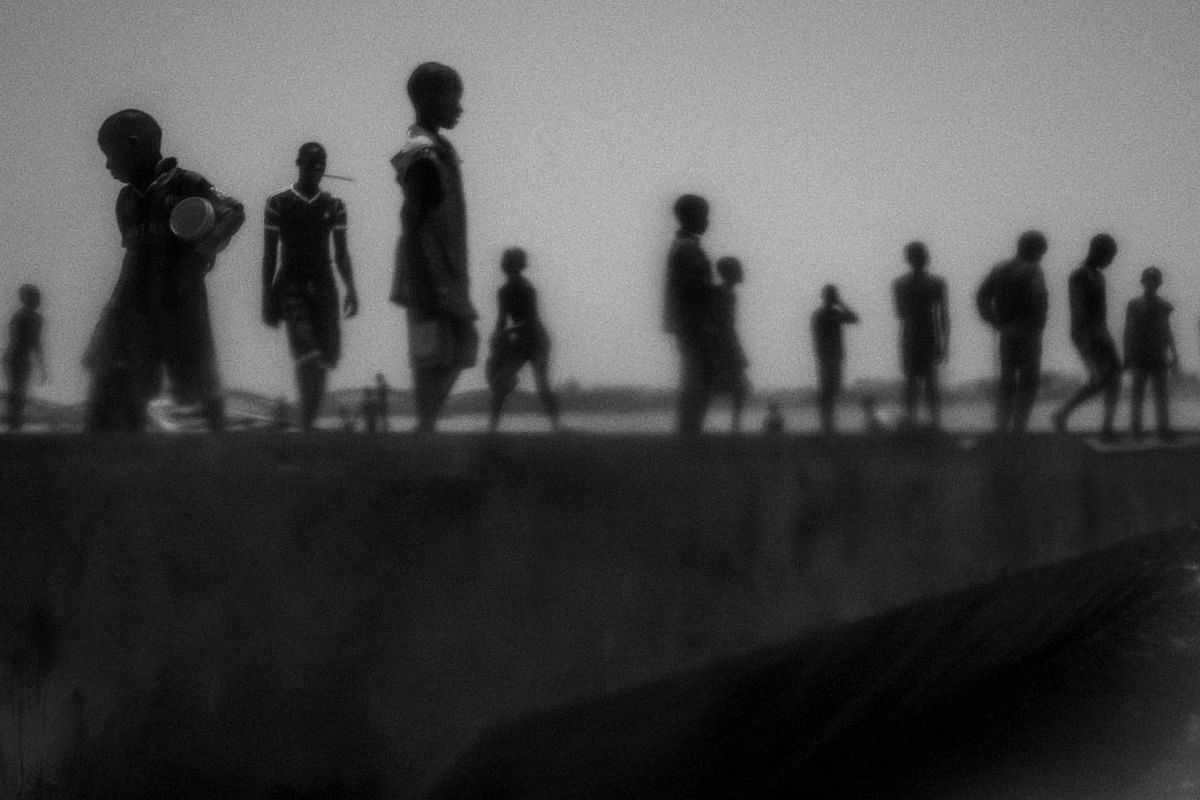 Runaway talibes stand on the bank of Senegal river, Saint Louis, Senegal, on May 20, 2015.
