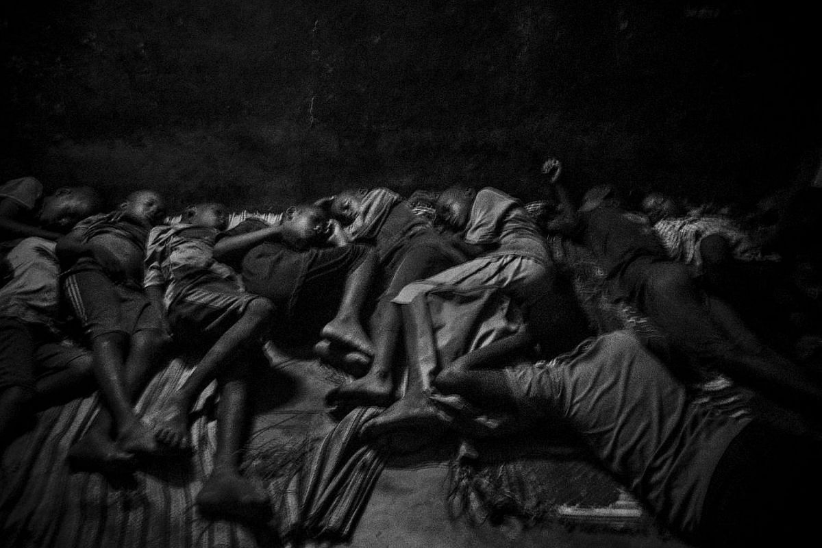 Talibes sleep next to each other inside a daara on the concrete floor without any protection, in Saint Louis, Senegal, on May 21, 2015.