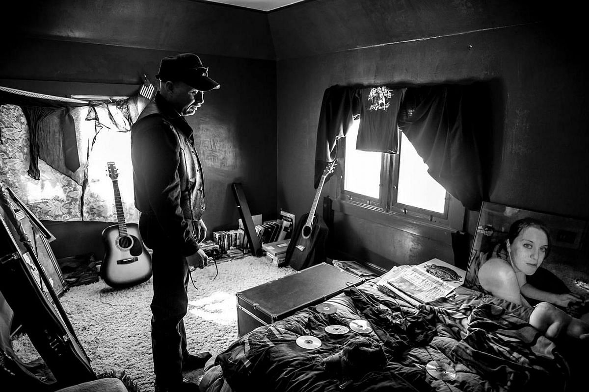 Gary Noling stands in his daughter Carrie's bedroom, on the anniversary of her suicide. She drank herself to death following severe retaliation after reporting her rape to superiors.
