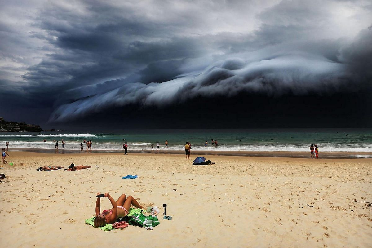A massive shelf cloud moves towards Bondi Beach. The cloud was part of a weather front that brought violent thunderstorms, with local media reporting damaging winds, hailstones the size of golf balls, and heavy rainfall. Shelf clouds are low cloud ba