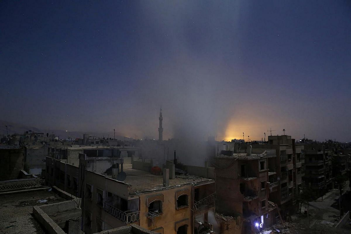 Smoke billows from a building in Douma, Syria, on Oct 30, 2015.