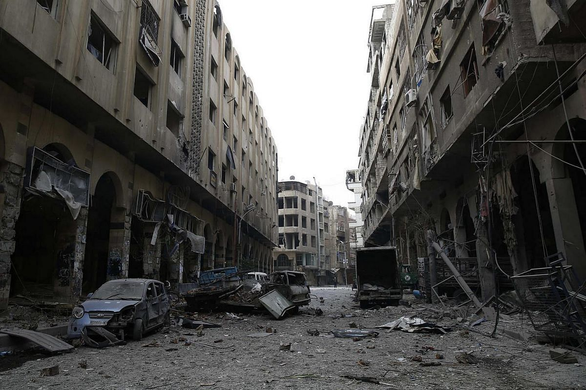 A street in Douma following an airstrike. The SOHR put the death toll at 28, though other estimates were higher.