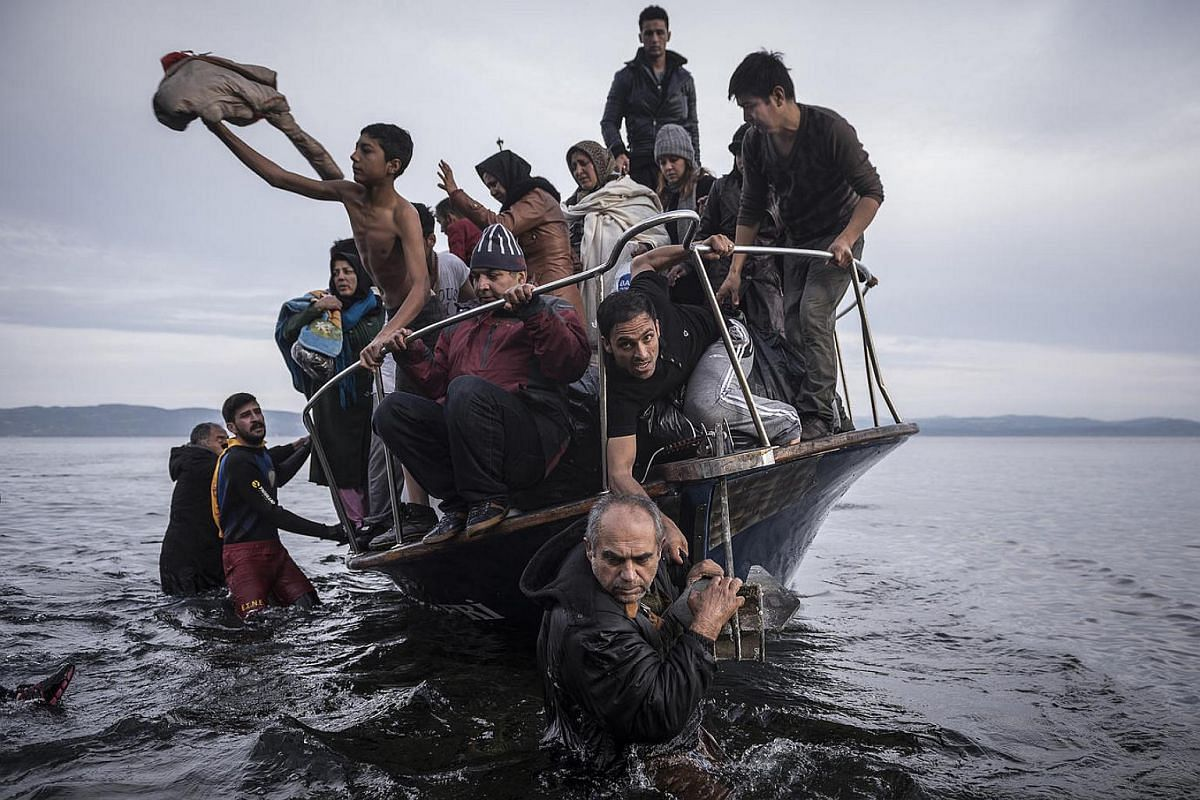 Refugees arrive by boat near the village of Skala on Lesbos, Greece, on Nov 16, 2015.