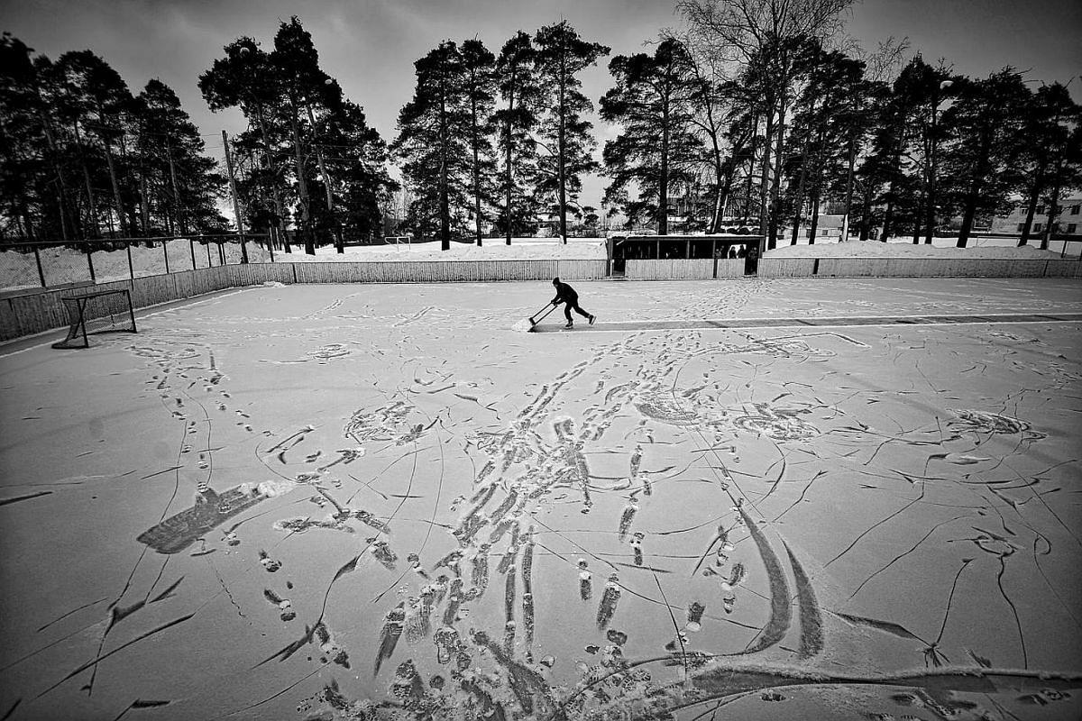 Team coach Evgeny Solovyov prepares the stadium for a match.