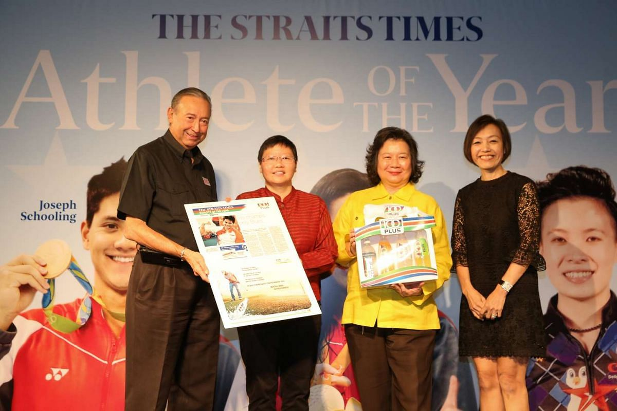 (Left to right) Colin Schooling, The Straits Times sports editor Lee Yulin, May Schooling and Jennifer See, general manager of F&N Foods Singapore.