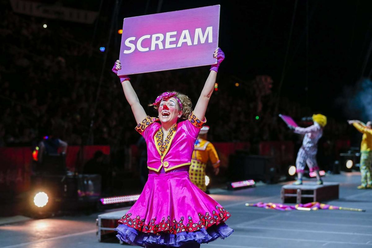A clown holds up a placard during a performance of the Ringling Bros. and Barnum and Bailey Circus at the Philips Arena in Atlanta, Georgia, on Feb 15, 2017.