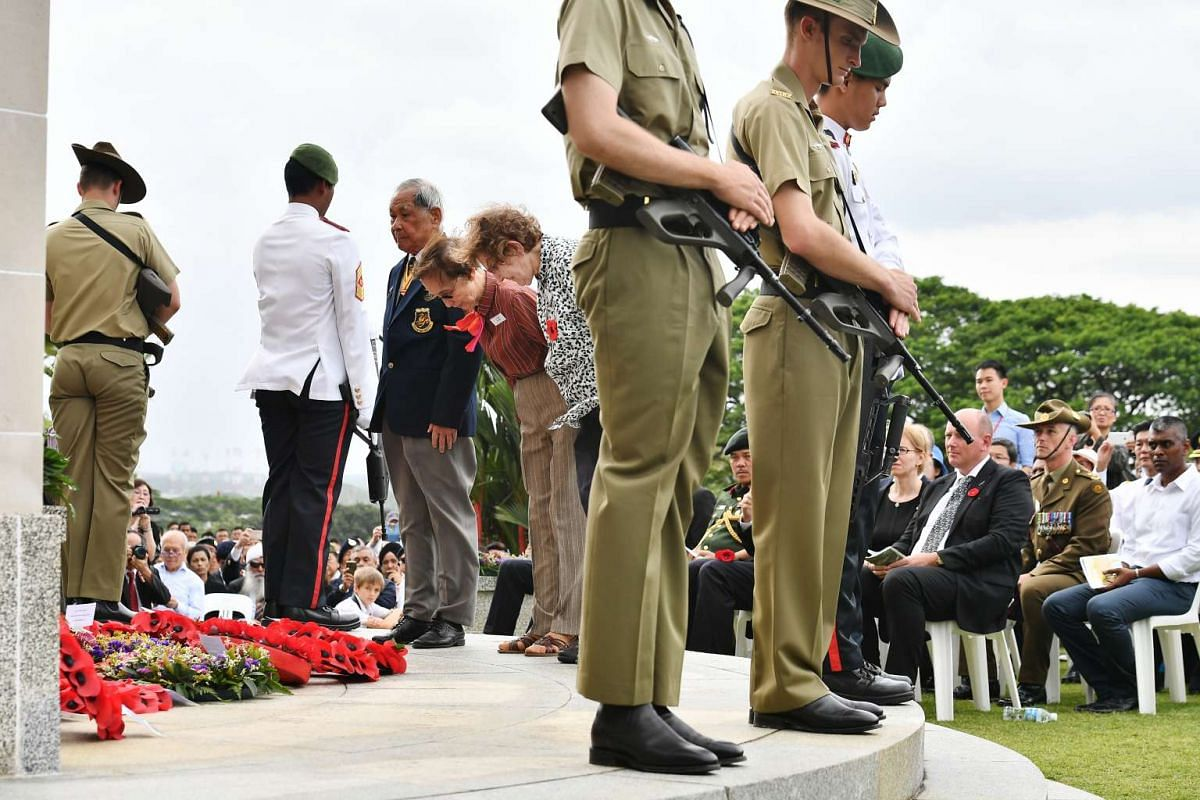 (From left) Captain Ho Weng Toh, a WWII Veteran Pilot, Mrs Vilma Howe, Former Civilian Internee, and Ms Olga Henderson, Former Civilian Internee, laying wreaths at the remembrance ceremony at Kranji War Cemetery, on Feb 15, 2017.