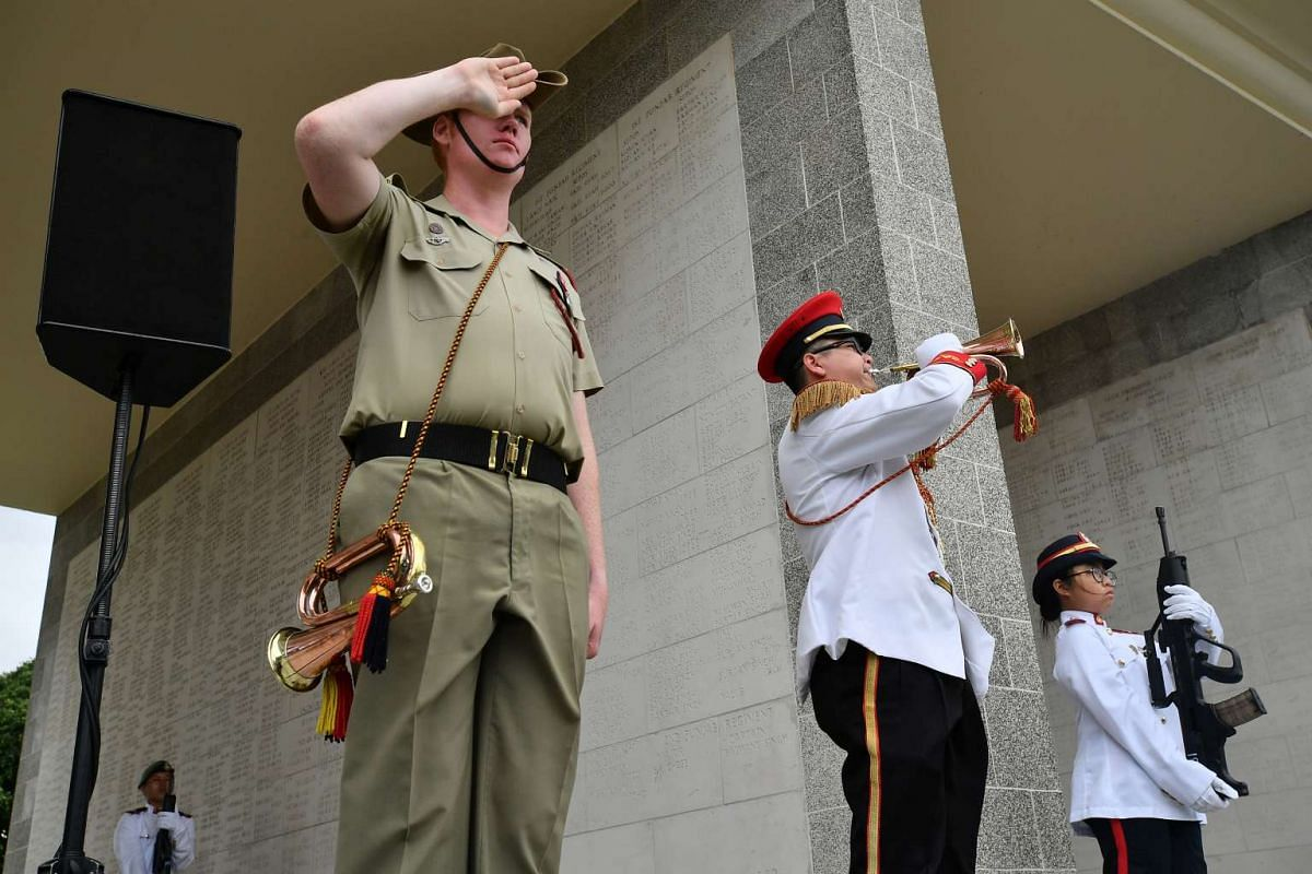 The Last Post during the remembrance ceremony, at Kranji War Cemetery, on Feb 15, 2017.