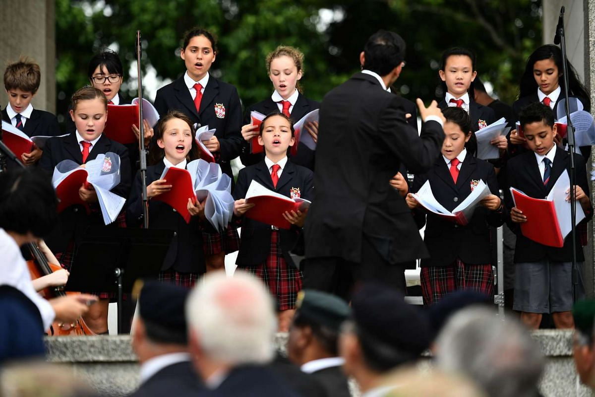 Dulwich College Choir singing at the remembrance ceremony, at Kranji War Cemetery, on Feb 15, 2017.