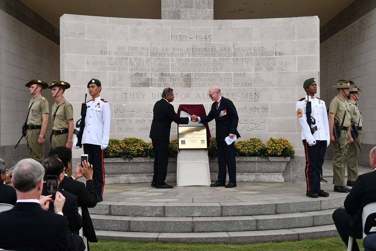 Unveiling of Commemorative Plaque by a Commissioner of the Commonwealth War Graves Commission (right), Lieutenant-General and Chairman of the Commemoration Committee, Sir William Rollo, and Mr Jeya Ayadurai, at a remembrance ceremony, at Kranji War C