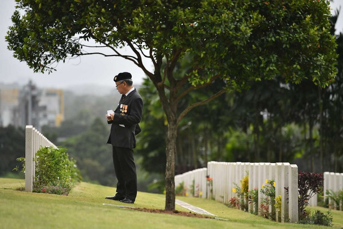 "Maj (Ret) Yap Siang Yong, member of Singapore Armed Forces Veterans' League, looking for tombstones of members of ""Z"" Special Unit, after the remembrance ceremony at Kranji War Cemetery, on Feb 15, 2017."