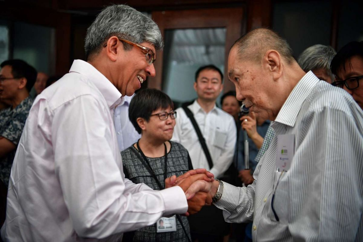 Minister for Communications and Information Dr Yaacob Ibrahim meeting war survivor Foong Fook Kay, after touring the new World War II exhibition - Syonan Gallery.