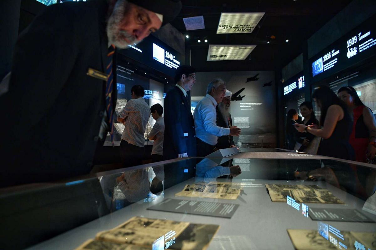 SAF veterans and other guests touring the new World War II exhibition - Syonan Gallery.