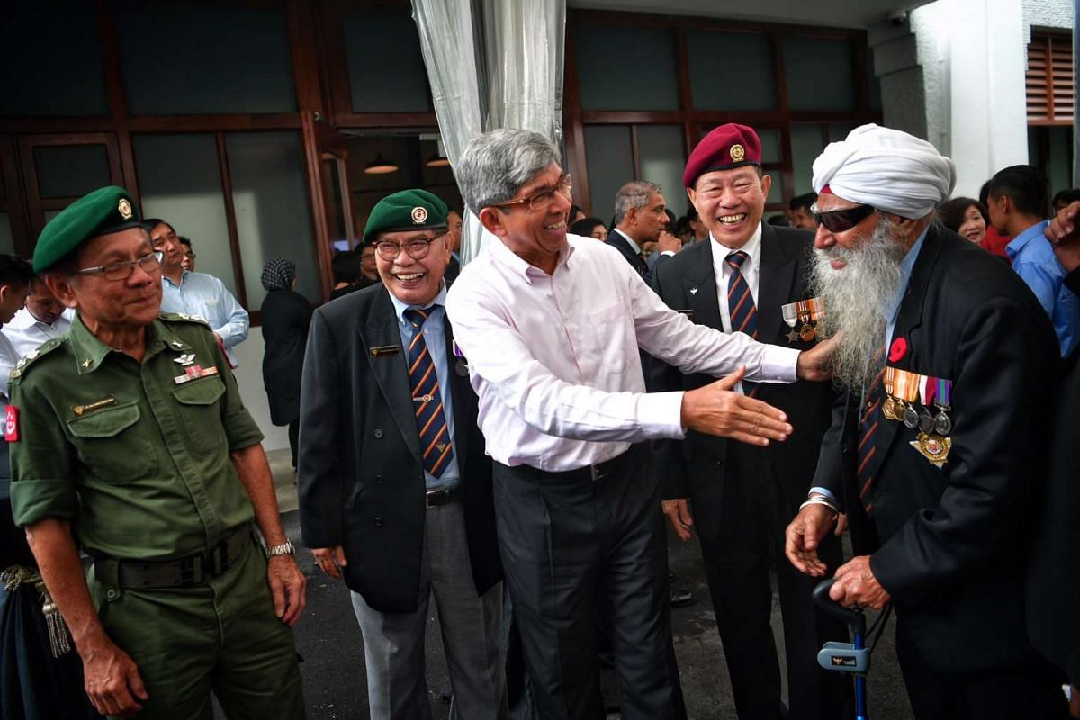 Minister for Communications and Information Dr Yaacob Ibrahim (centre) meeting SAF veterans after touring the new World War II exhibition - Syonan Gallery.