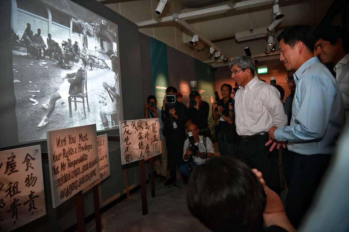 Minister for Communications and Information Dr Yaacob Ibrahim (centre) and Education Minister (Higher Education and Skills) Ong Ye Kung (right) touring the new World War II exhibition - Syonan Gallery.